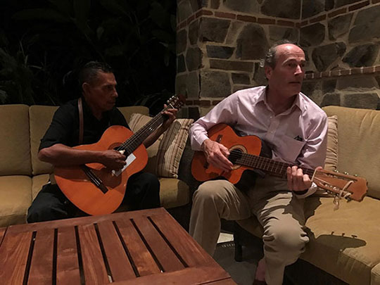 Bill plays the guitar with Jorgelito, the resident singer at Rancho Santana
