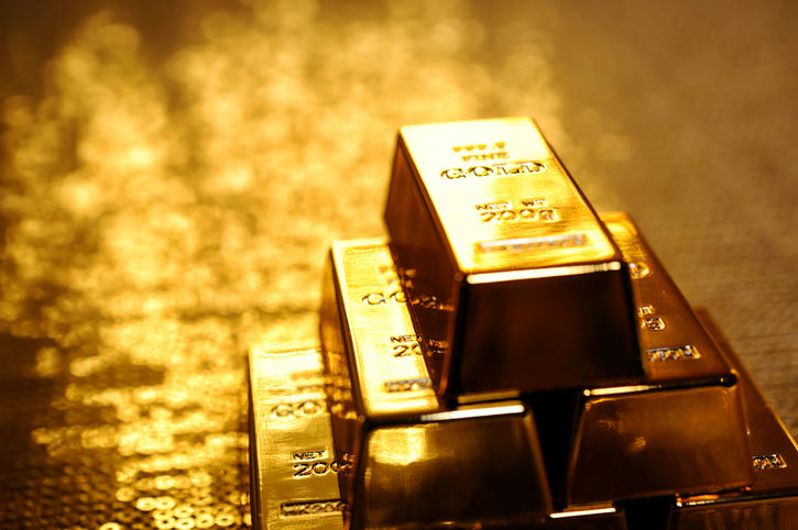 Picture of a stack of gold bars as a metaphor of gold goes up