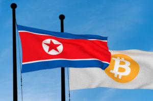 North Korean flag and Bitcoin Flag waving over blue sky